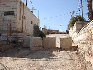 Metre square cement roadblocks used to restric...