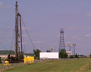 English: The Russell oil derrick sign off Kans...