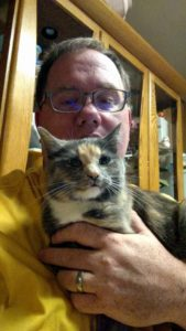 Our cat Cinnamon and I.